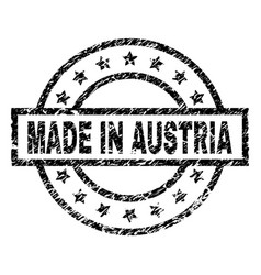 Grunge textured made in austria stamp seal vector