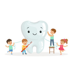 Happy kids cleaning a big tooth with a brush and vector