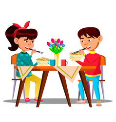 two hungry little asian kids at the table eating vector image