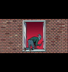 thief is a burglar climbs in window vector image
