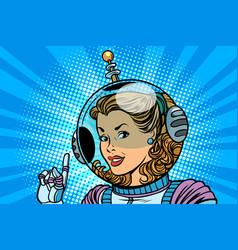 Woman cosmonaut finger indicates vector