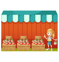 A fruitstand with a young girl vector image