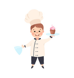 Cute boy chef cook holding platter with cupcake vector