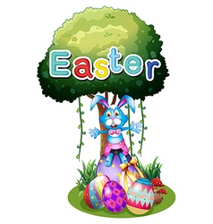 Easter eggs and a bunny under the tree vector image