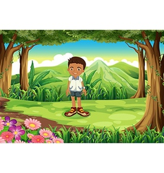 A schoolboy in the middle of the forest vector image