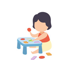 cute little boy playing with sorter toy vector image