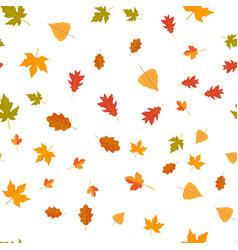 Seamless pattern of autumn yellow leaves randomly vector