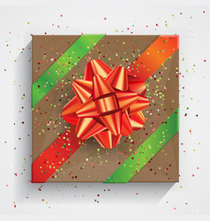 Gift box wrapped on brown wrinkled paper with red vector
