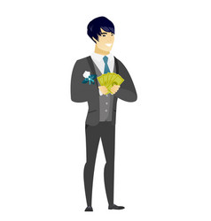 Happy asian groom holding money vector