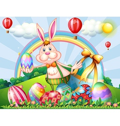 A bunny at the hilltop with Easter eggs vector