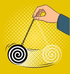 Hypnotizer pendulum in hand pop art vector