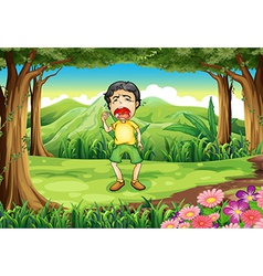 A boy crying at the woods vector
