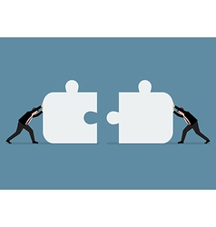 Businessmen pushing two jigsaw pieces together vector image