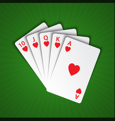 A royal flush of hearts on green background vector