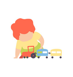 cute little boy sitting on floor playing with toy vector image