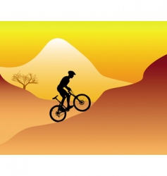 Mountain biker riding down hill vector