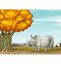 A rhinoceros near the tree vector