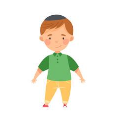 Jew boy in skullcap standing and smiling vector