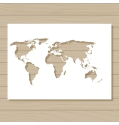 stencil template of world map on wooden background vector image