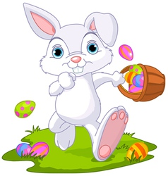 easter bunny hiding eggs vector image