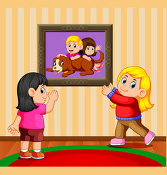 two girls holding the photo frame vector image