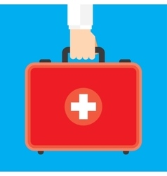 Hand Holding First Aid Box vector image vector image
