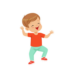 Cute smiling little boy dancing in casual clothes vector