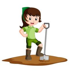 farmer girl holding a shovel vector image