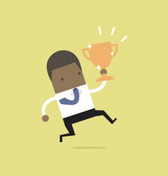 african businessman jumping and holding trophy vector image