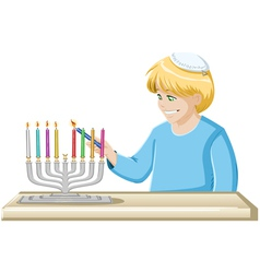 Boy Lights A Hanukkiah Candle vector image