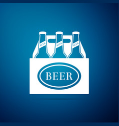 Pack of beer bottles icon on blue background vector