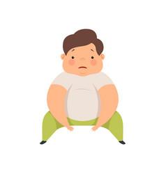 Cute overweight boy sitting on the floor chubby vector