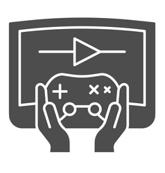 Joystick in hands solid icon joypad in arms and vector