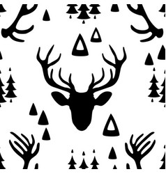 Seamless pattern with deer heads vector