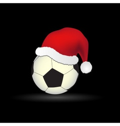 soccer and football ball with red santa hat eps10 vector image