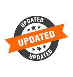 Updated sign updated orange-black round ribbon vector