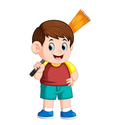 Boy using the red clotheis holding the broom vector
