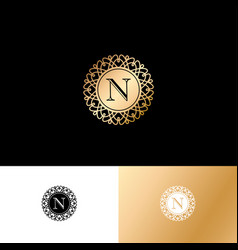 N gold letter monogram gold circle lace ornament vector