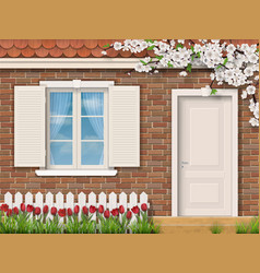 brick facade with window fence tulips vector image vector image