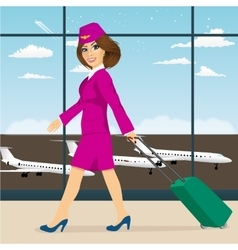Stewardess walking through airport terminal vector