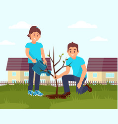 two smiling volunteers planting tree little vector image