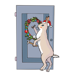 christmas rabbit nails a wreath to the door vector image