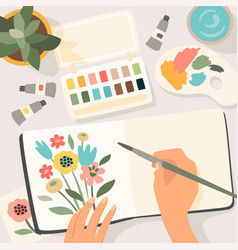 Stay at home woman paints flowers in sketchbook vector