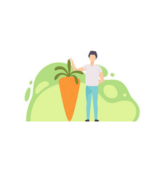 Young man standing next to giant ripe carrot vector