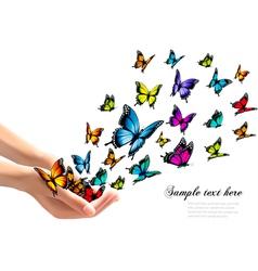 Hands releasing colorful butterflies vector image