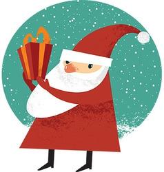 Santa Claus holding a Christmas gift vector image