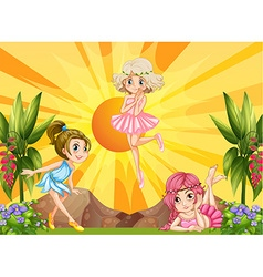 Three fairies flying in the garden vector