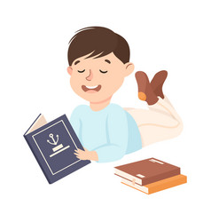 Happy boy lying on floor and reading book vector
