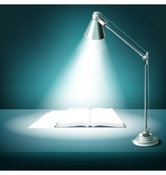 Opened book on table with desk lamp vector