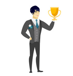 Asian groom holding a trophy vector
